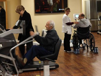 Resident using SciFit exercise machine