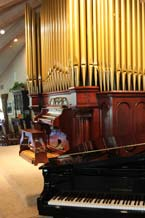 Pipe organ and piano in activity room
